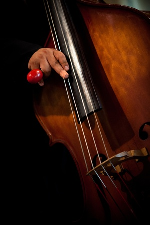 chambers: playing double bass with bandage on finger