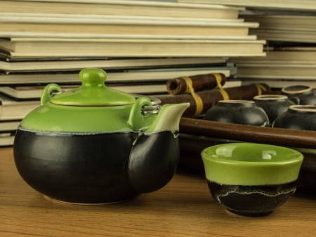 teapot and books for relaxing time photo