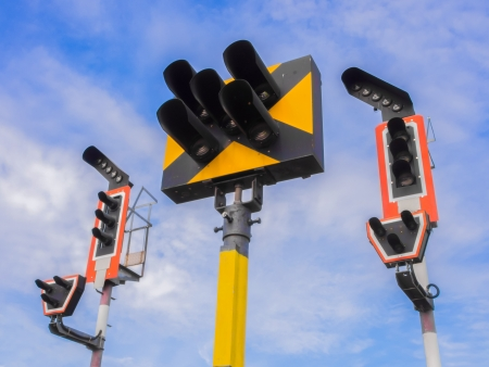Train traffic light system with blue sky background