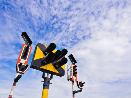 Train traffic light system with blue sky background photo