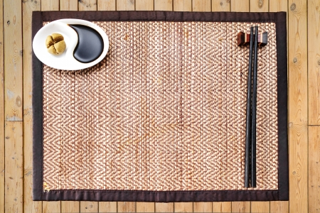 sause: wasabi and Japanese sause   chopsticks on a bamboo mat without any meal or food  Empty space in the middle for any japanese food insert Stock Photo