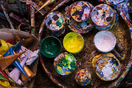 hazardous: used paint buckets for artist