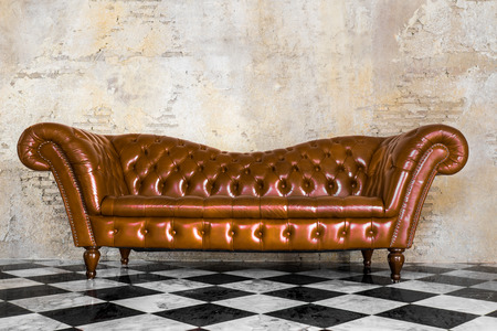 leather sofa: vintage style of interior decoration the leather sofa with black and white floor and concrete wall