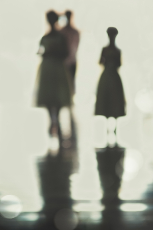 vintage art image of blurry silhouette of flower girls walking down aisle photo