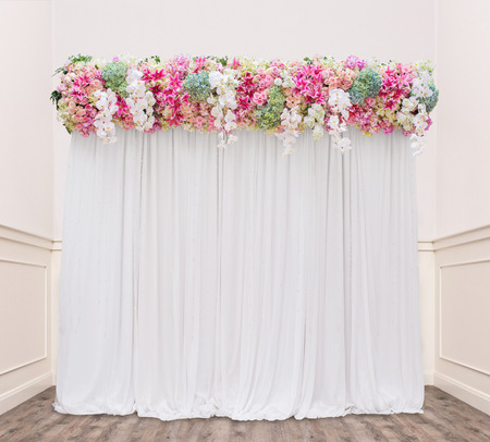 floral backdrop in cozy room at the wedding