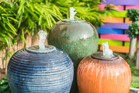 colorful decorative water jar in the garden photo