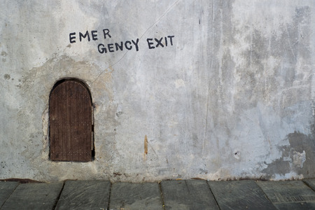 Emergency exit mouse hole with wooden door photo