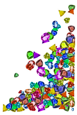colorful gems falling down isolate on white background photo