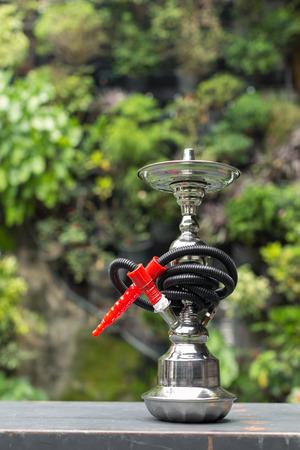 baraku or shisha tobacco water pipe in the garden photo