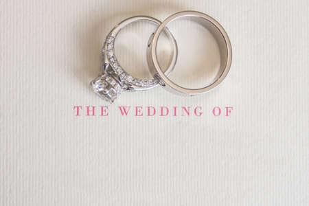 wedding card with blurry wedding rings photo