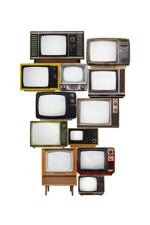 television antigua: la imagen aislada de muchos televisores de época con cristal de la pantalla vacía para texto o gráfico Foto de archivo