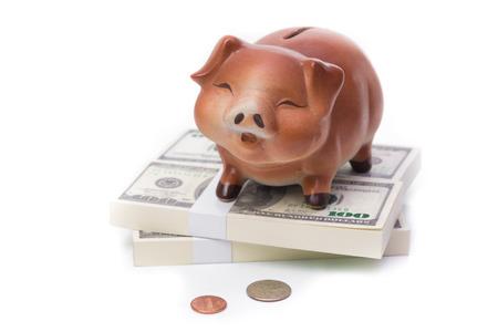 Ceramic piggy bank on dollars bills Standard-Bild - 111237072