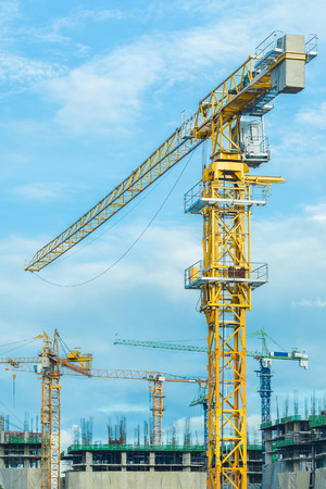 Construction crane operating with blue sky Standard-Bild - 111237073