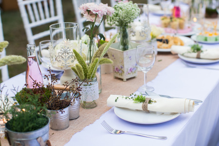 Outdoor catering dinner at the wedding with homemade garnishes decoration Stock Photo