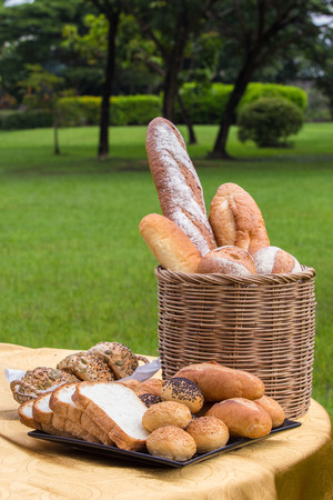 Various kinds of bread served on table in the garden Standard-Bild - 111237074
