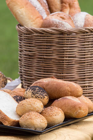 Various kinds of bread served on table in the garden Standard-Bild - 111237075