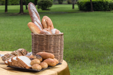 Various kinds of bread served on table in the garden Standard-Bild - 111237076
