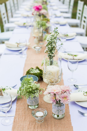 Outdoor catering dinner at the wedding with homemade garnishes decoration Reklamní fotografie