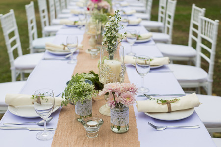 party table: Outdoor catering dinner at the wedding with homemade garnishes decoration Stock Photo