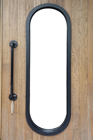 Wooden door with capsule shaped black steel frame in the middle, the reflective glass replaced with white background