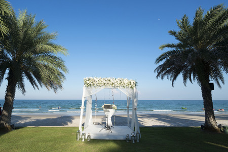 Wedding chuppah arbor by the beach in summer time Фото со стока