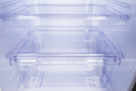 Transparent plastic chamber in refrigerator to store vegetables Archivio Fotografico