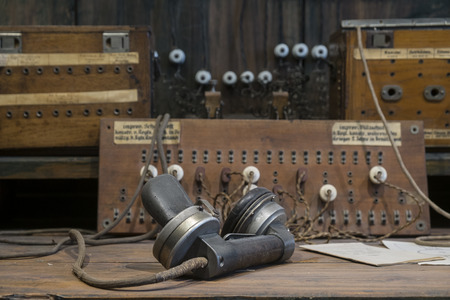 Very old telecommunication system on rustic wooden table