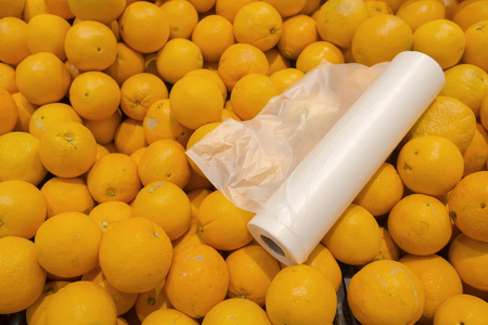 Roll of plastic bag for customer to put oranges in when purchase