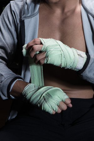 Boxer prepare his fists before practicing