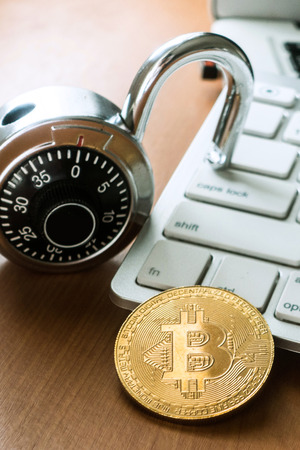 Bitcoin with lock and keyboard, conceptual photography, cryptocurrency safety