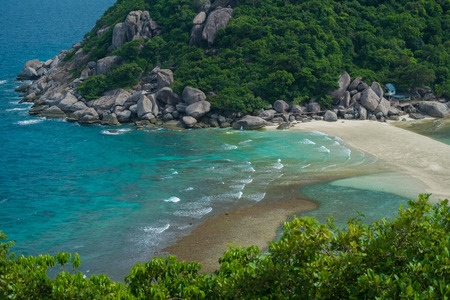 Wave hitting the beach with mountain background. Aerial photography from above of beach at Koh Nangyuan Thailand. Stok Fotoğraf