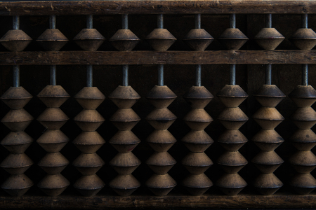 Close up wooden Chinese abacus in dark environment