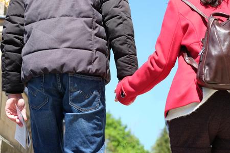 Tourist holding hand walking in park Stok Fotoğraf