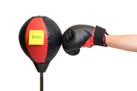 Punching practice boxer standing bag with paper post says BOSS, isolated on white background