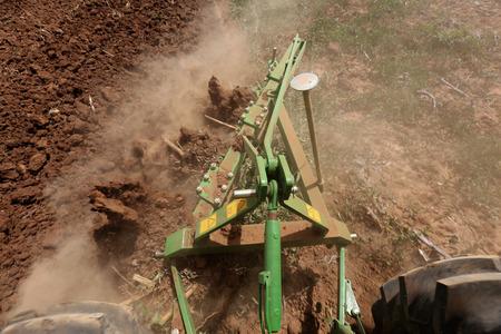 Steel plough plowing soil land preparing for plantation Stok Fotoğraf
