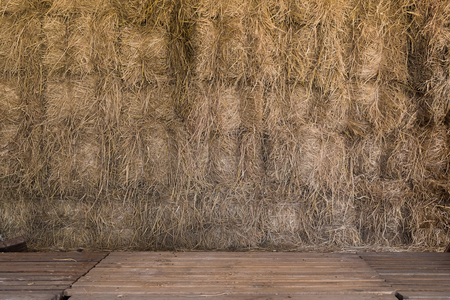 Background of hay bale in warehouse with wooden foreground floor Stok Fotoğraf