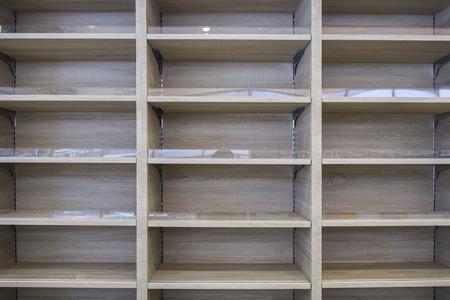 Built-in wooden shelf in store, empty Stok Fotoğraf