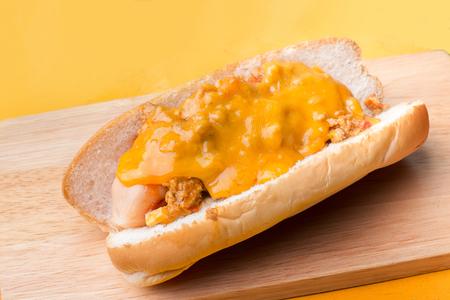 Hot dog cheese on wooden platter Stok Fotoğraf