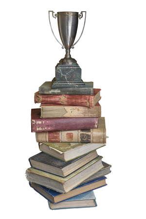 Stack of old vintage books with retro trophy on top isolated on white background Stok Fotoğraf