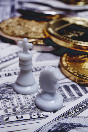 Chess pieces with bitcoins on US dollars background, conceptual photography, money game Stok Fotoğraf - 119845617