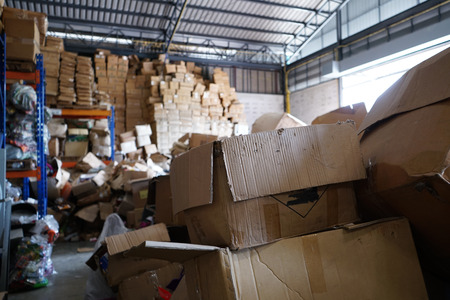 Blurry image of poorly organized warehouse with a lot of messy stocks and boxes Reklamní fotografie