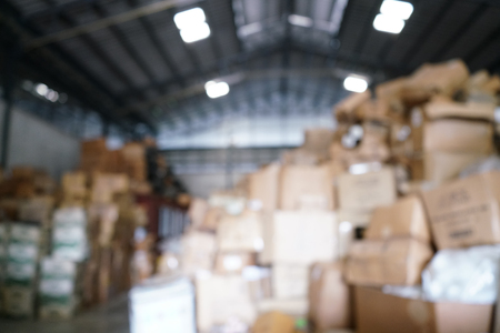 Blurry image of poorly organized warehouse with a lot of messy stocks and boxes 版權商用圖片