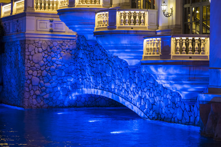 LED light from underwater illuminating stone bridge in Las Vegas