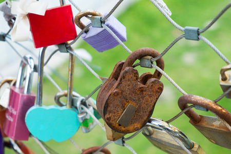 Close up image of old lock on bridge fence, for lover who believe that they will be together forever