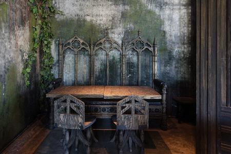 Scary dining table in ghost haunted looking house Archivio Fotografico
