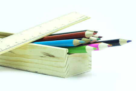 Colorful wooden color pencil in wooden box on white background