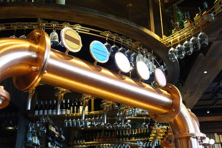 Brass beer tab in the bar