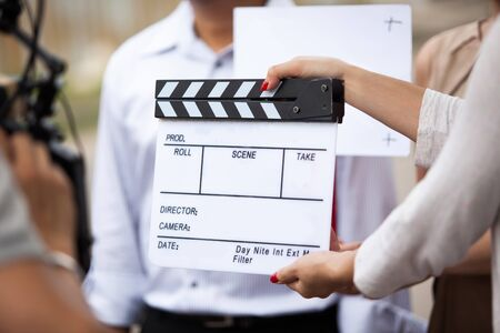 Female hands of movie crew holding clapperboard in the movie set Stock fotó