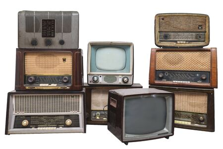 Old vintage radios and televisions isolated on white background with clipping path. All logos and trademarks have boon removed Stock Photo