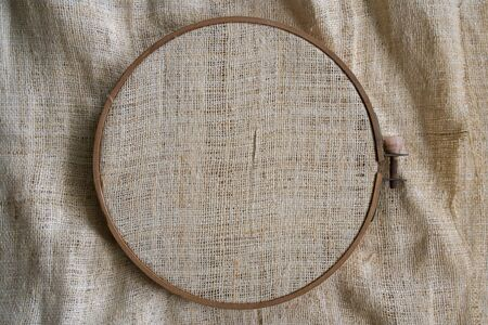 Wooden hoop with sackcloth sewing hobby 免版税图像